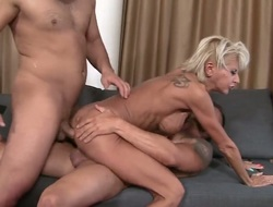 A XXX milf is getting pain in the neck fucked whilst she is giving a blow job. She likes to have sexual congress in a troika since then on all sides of her holes get rolling in it at once.