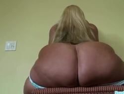 A big buxom ass sits down