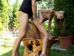It is a sunny show one's age out, so the golden haired girl Doris Ivy is out with her lover in the garden. She is receiving an anal gangbang from the man and she sucks him off.