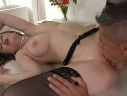 Tina Kay is a slender brunette in some black underclothing and stockings and she is having her tight little fanny licked up real fine and hard in this great fucking session photograph